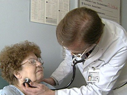A picture of a doctor examining a patient.