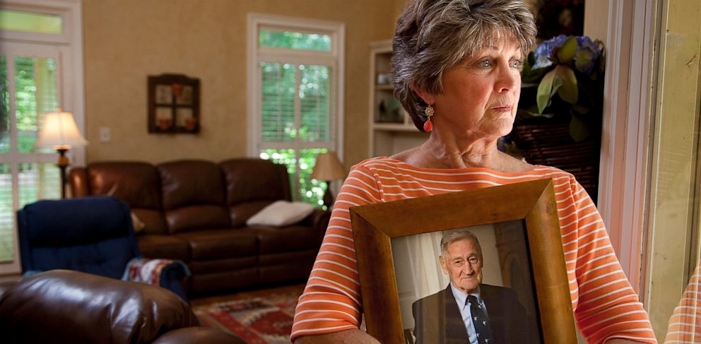 PHOTO: Cheryl Morgan holds a photo of her late father, who had dementia and died after drinking toxic dishwashing liquid at a Georgia assisted-living facility.