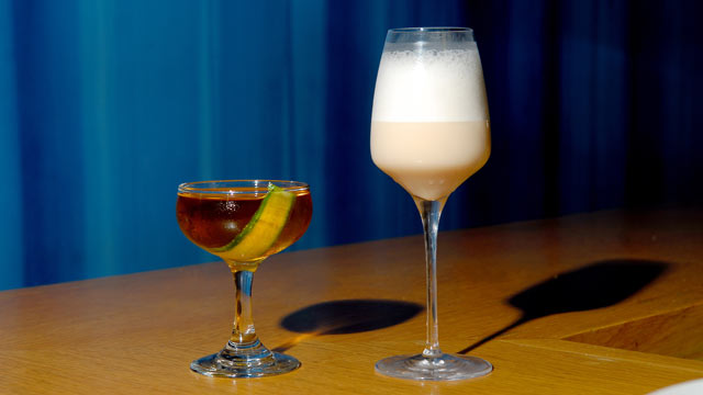 PHOTO: Aldea's Raymos Gin Fizz and Coastal Reign cocktail are seen here.