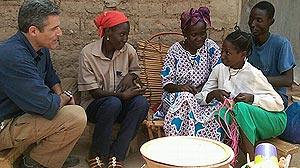 PHOTO: Dr. Besser and a family in Burkina Faso.