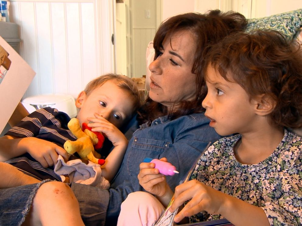 Michelle Bader is shown here with the twins she gave birth to through the help of egg donation.