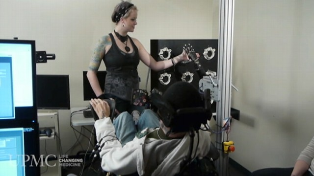 VIDEO: Tim Hemmes touches his long-time girlfriend using mind-controlled robotic arm.