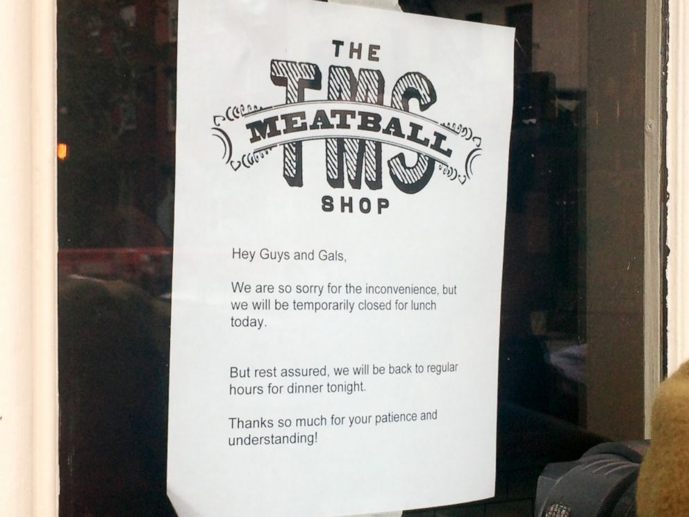 PHOTO: A sign on the front door of The Meatball Shop on Greenwich Avenue in the Manhattan borough of New York City says that the shop is closed for lunch but will reopen for dinner on Oct. 24, 2014.