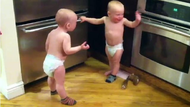 PHOTO: Twin boys have a conversation together in baby talk