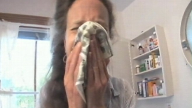 Video: Woman injects herself with cold virus.