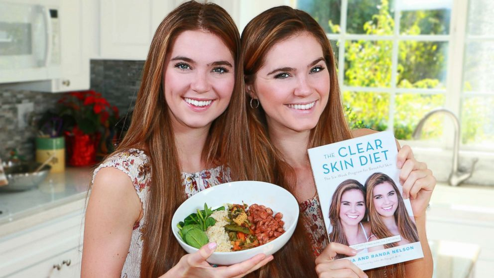 """Randa Nelson, left, and Nina Nelson, both 24, pose with their new book, """"The Clear Skin Diet."""""""