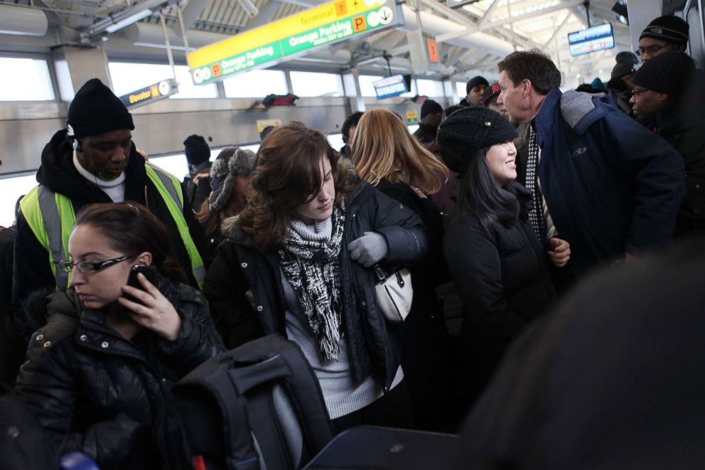 PHOTO: Passengers attempt to board an over crowded AirTrain at John F. Kennedy Airport on Jan. 27, 2011 in New York.