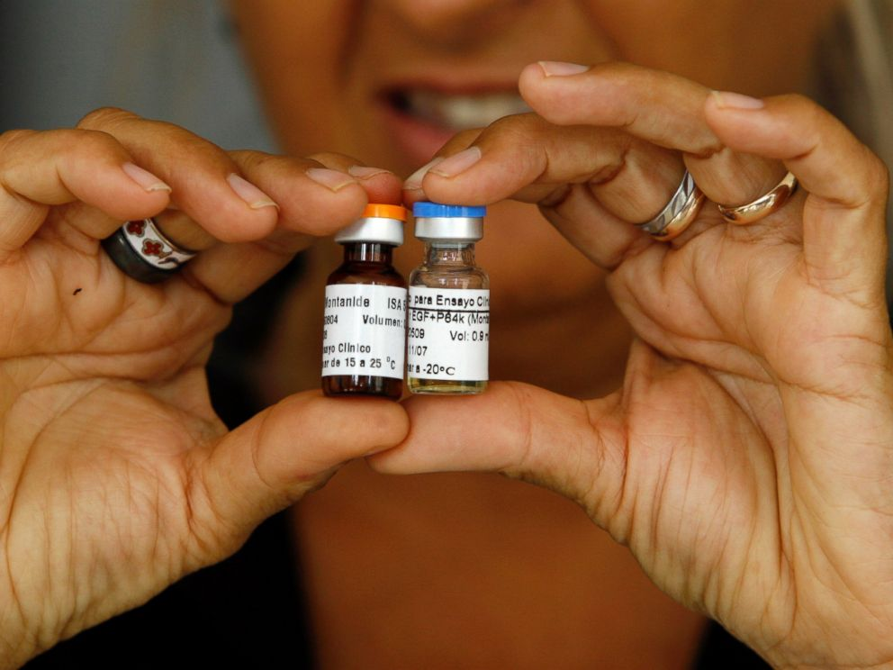 PHOTO: A Cuban health officer presents CimaVax EGF, medicine used in the treatment of advanced lung cancer, in Havana, June 24, 2008.
