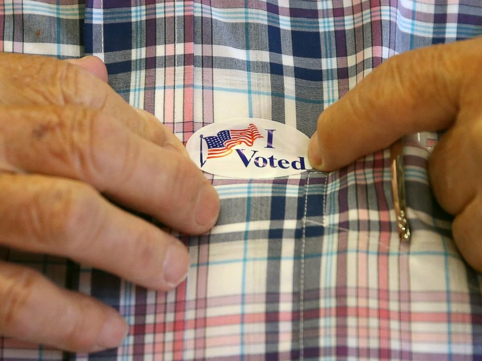 PHOTO: A man puts on a sticker after voting inside Brookside Engine Company 1 firehouse June 7, 2016, in Mendham Township, N.J.