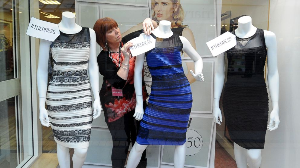 Shop manager Debbie Armstrong adjusts a two tone dress in a window display of a shop in Lichfield, England on Feb. 27, 2015.