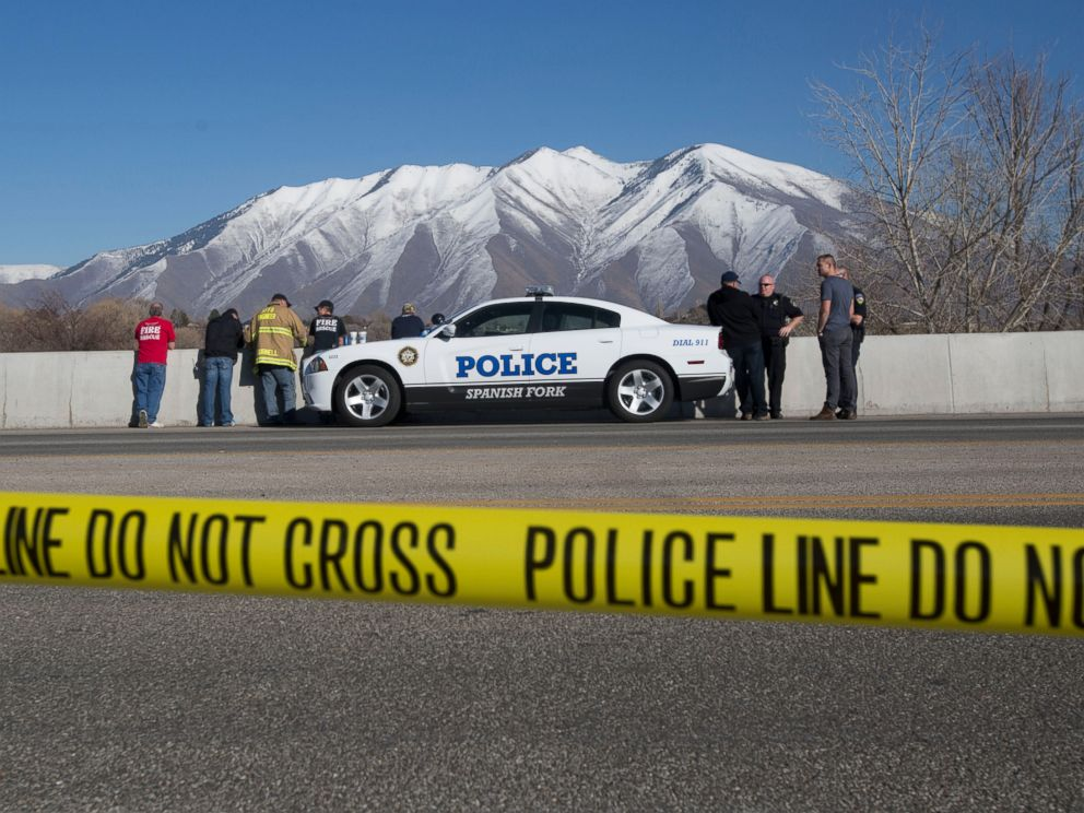 PHOTO: In this March 7, 2015 photo, officials respond to a report of car in the Spanish Fork River in Spanish Fork, Utah. An 18-month-old girl survived.