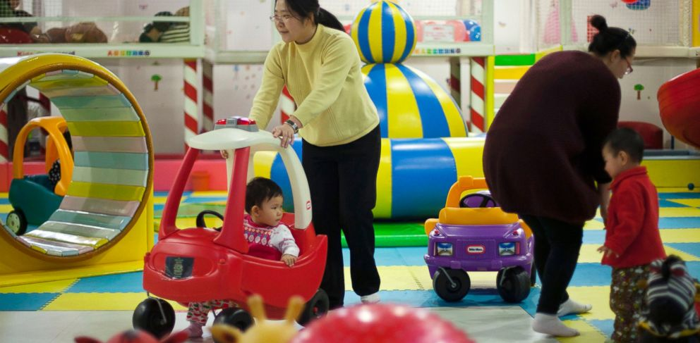 PHOTO: In this Jan. 10, 2013 photo, parents play with their children at a kids play area in a shopping mall in Beijing.