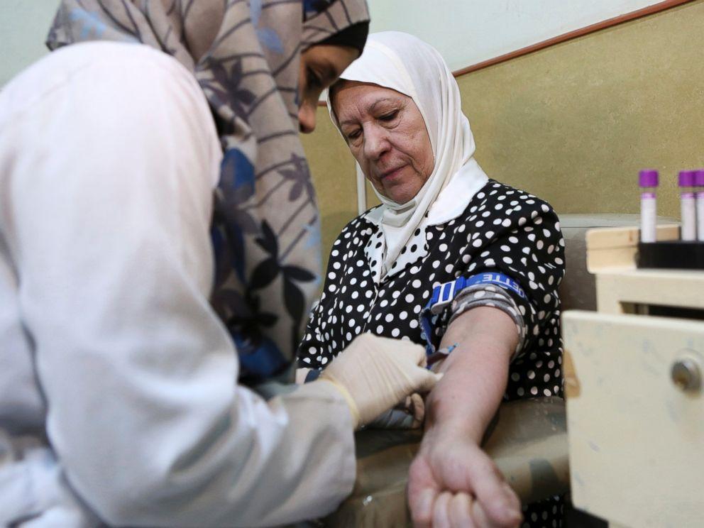 PHOTO: A nurse takes blood from a patient at Jordans National Center for Diabetes in Amman, Jordan, June 14, 2015.
