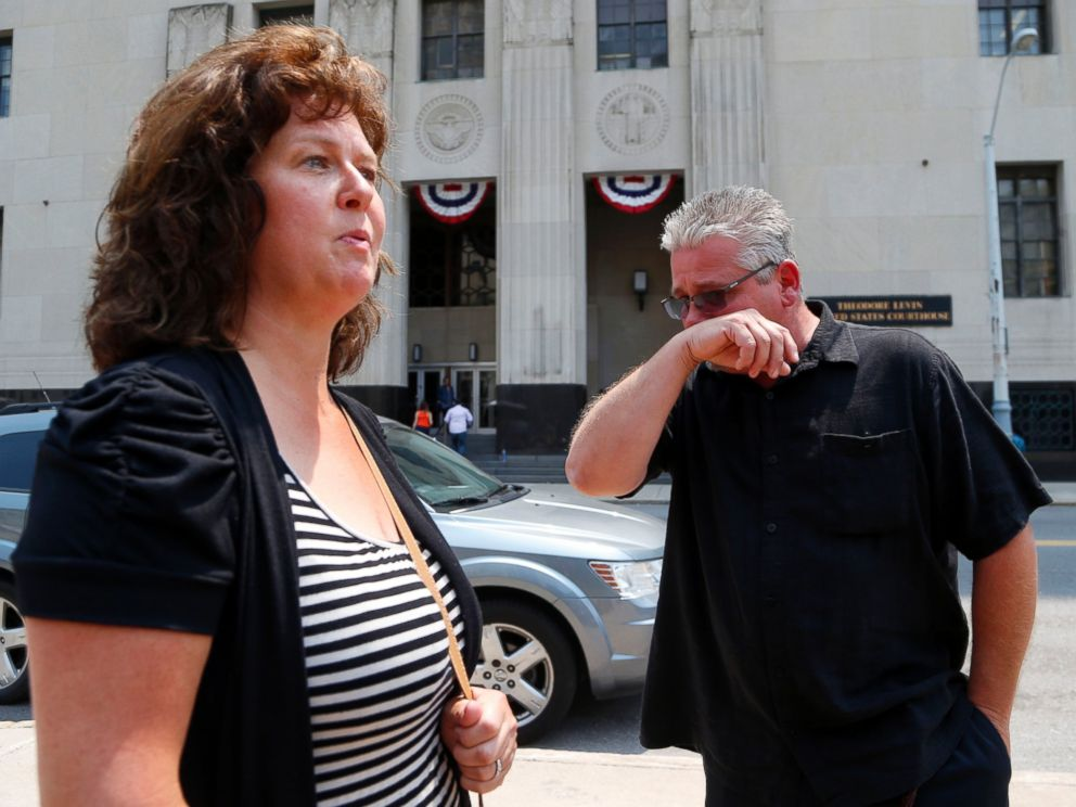 PHOTO: Terry Spurlock, right, of Holly, Mich., a former patient of Dr. Farid Fata, speaks with his wife Nikii outside federal court, July 6, 2015, in Detroit.