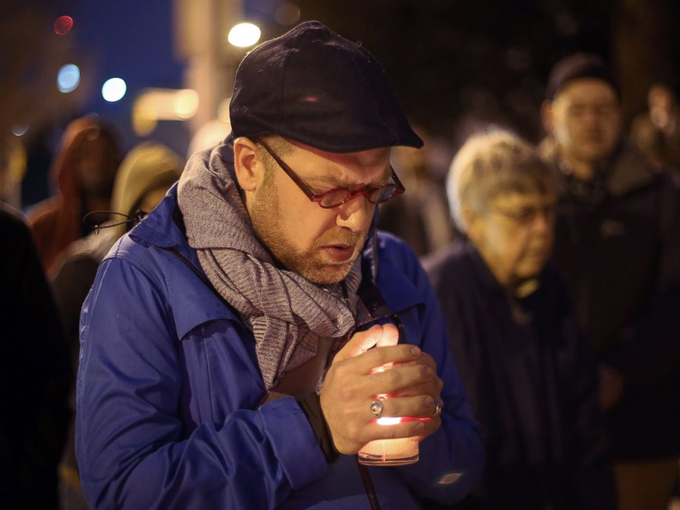 PHOTO: Michael Patter, senior minister at Central Congregational United Church of Christ, prays silently during a vigil for Kelly Gissendaner and protest against the death penalty on March 2, 2015, on the steps of the State Capitol.