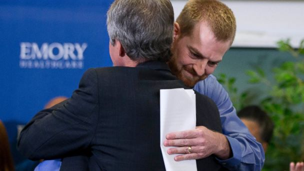 PHOTO: Ebola victim Dr. Kent Brantly, right, hugs a member of the medical staff that treated him, after being released from Emory University Hospital, Aug. 21, 2014, in Atlanta.