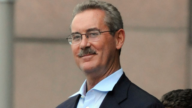 PHOTO: Billionaire R. Allen Stanford smiles as he is escorted out of the federal courthouse in Houston in this June 29, 2009 file photo.
