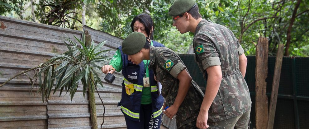PHOTO: A health agent from Sao Paulos Public health secretary shows army soldiers mosquito larvae that she found during clean up operation against the insect, which is a vector for transmitting the Zika virus, in Sao Paulo, Brazil, Jan. 20, 2016.