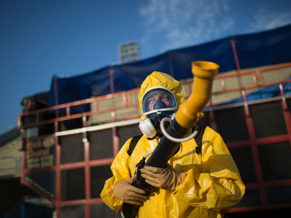 PHOTO: A health worker stands in the Sambadrome as he sprays insecticide to combat the Aedes aegypti mosquitoes that transmit the Zika virus, in Rio de Janeiro, Brazil, Jan. 26, 2016.