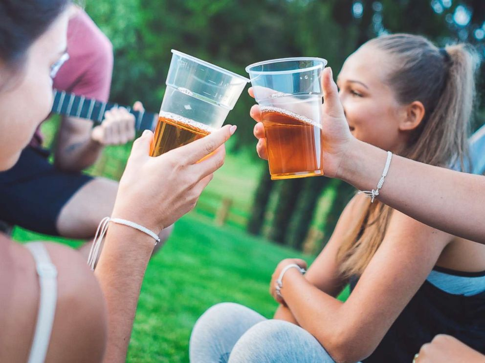 PHOTO: Young people drink beer outdoors in an undated stock photo.