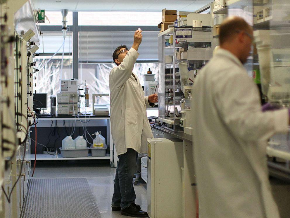 PHOTO: Lab employees work at Biogen Idec in Cambridge, Mass., April 25, 2013.