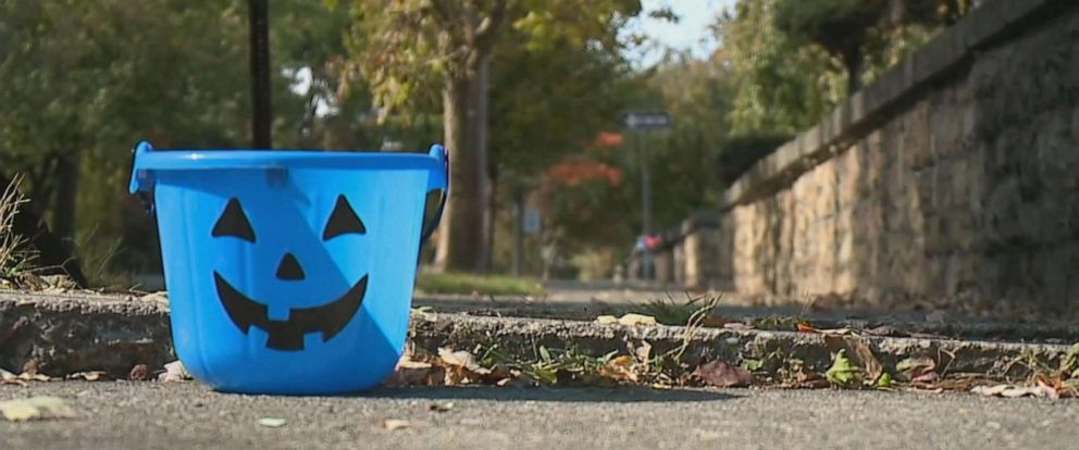 PHOTO: Blue buckets will be carried this Halloween for autism awareness.