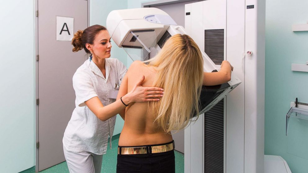 In this undated stock photo, a nurse with a young women having a mammography.