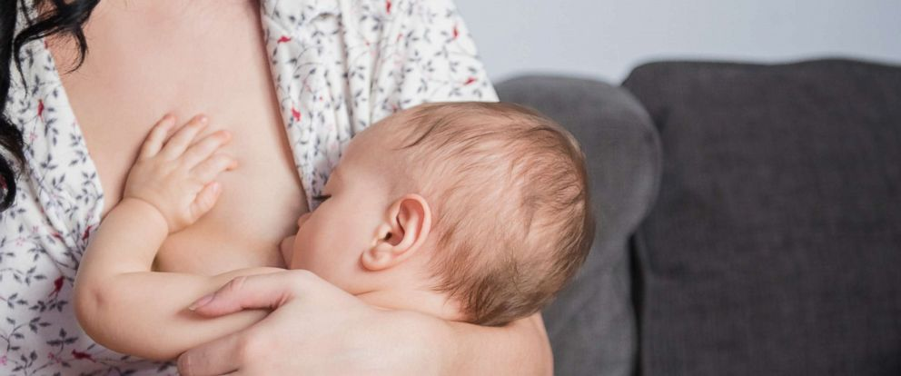 PHOTO: A mother breastfeeds her baby son.
