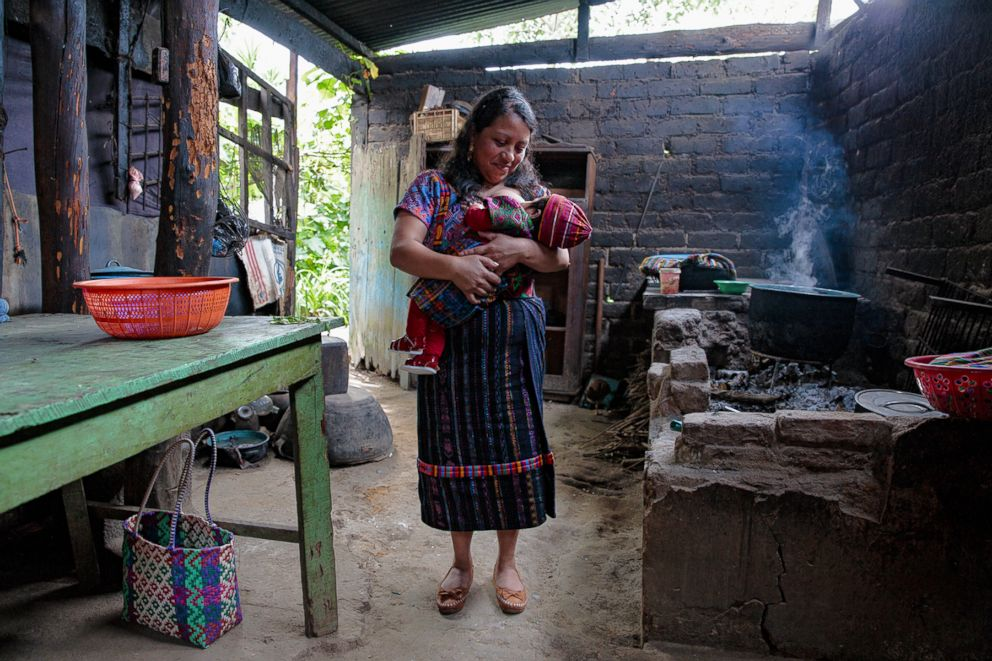 PHOTO: Sylvia poses while breastfeeding in Guatemala.