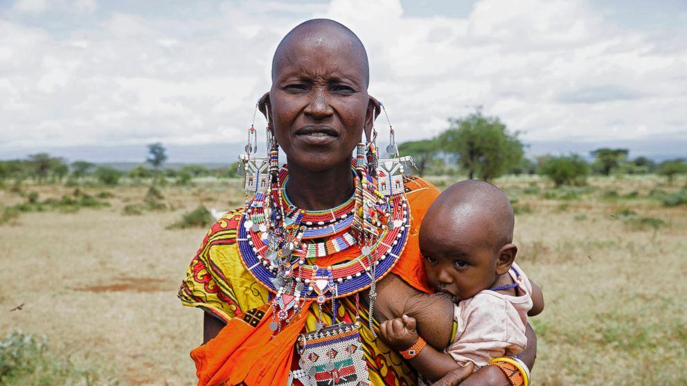 Loolei poses while breastfeeding in Kenya.