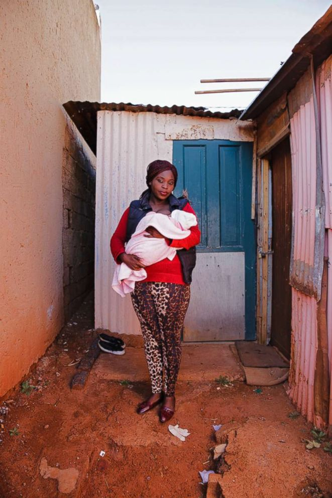 Eunice poses while breastfeeding in South Africa.