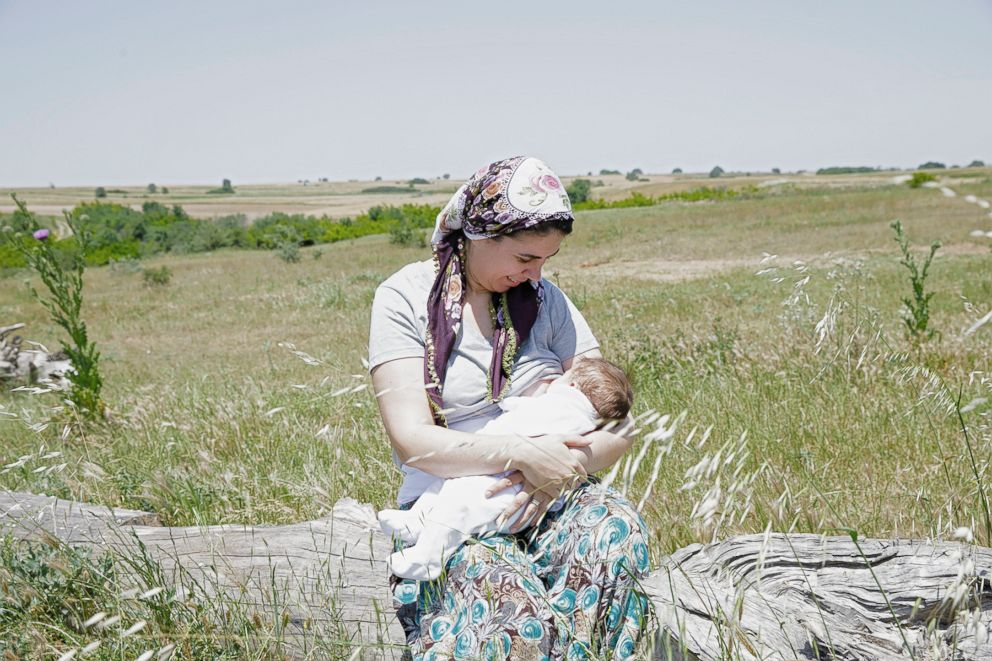PHOTO: Gulush poses while breastfeeding in Turkey.