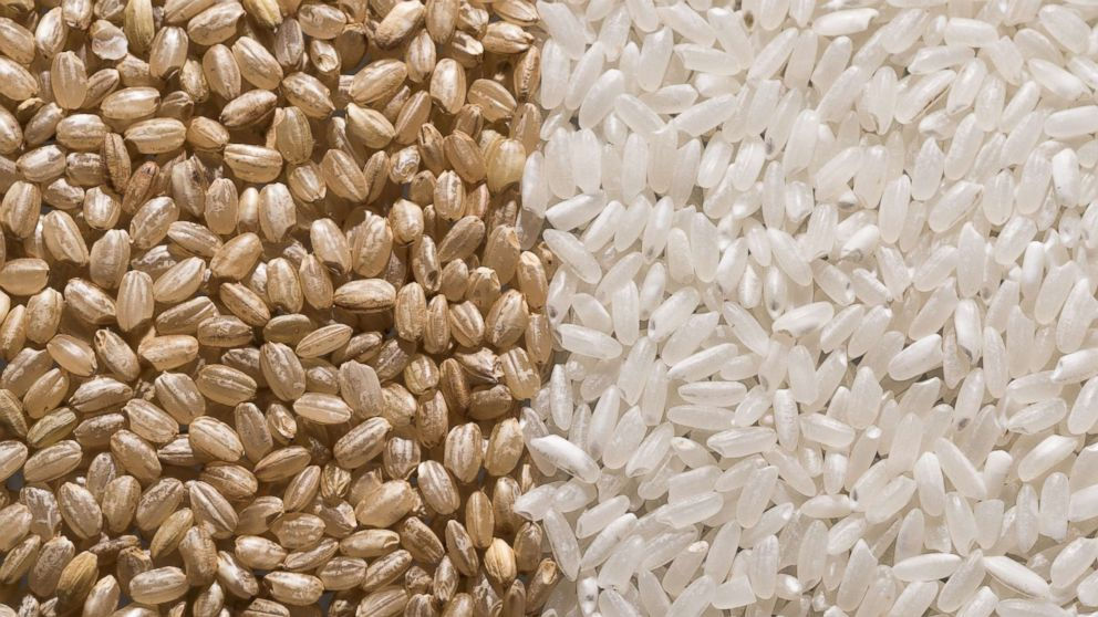 Brown rice and white rice are pictured in this undated stock photo.