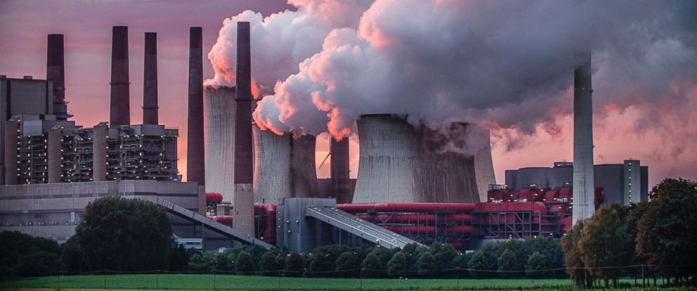 Chimneys and cooling tower of a coal fired power station are pictured in this undated stock photo.PHOTO:
