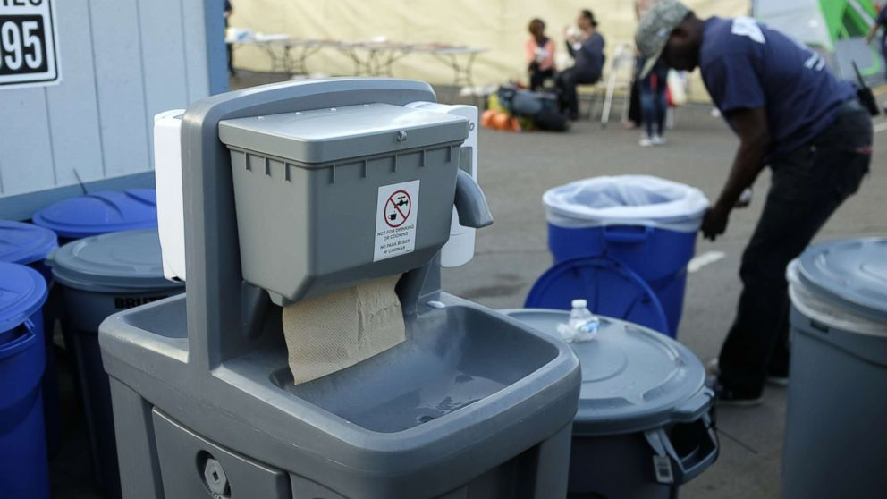 A hand washing station is seen near a tent city in San Diego as part of the city's efforts to combat a deadly hepatitis A outbreak, Oct. 9, 2017.