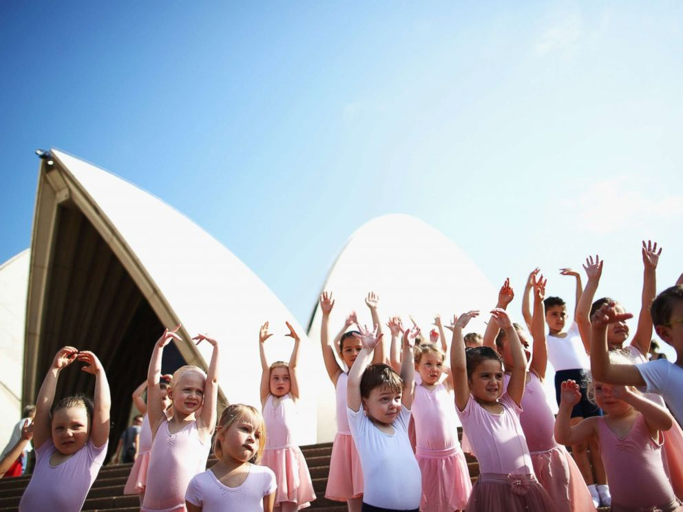 PHOTO: Young dancers perform during a outdoor ballet class on the steps of Sydney Opera House, on Oct. 9, 2015 in Sydney, Australia.