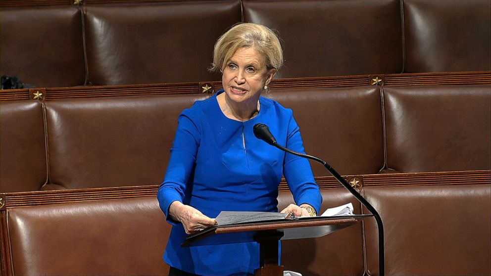 Rep. Carolyn Maloney peaks on the floor of the House of Representatives
