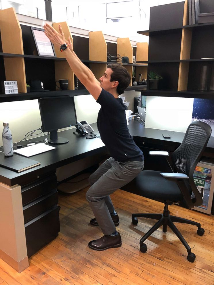 PHOTO: A chair pose variation pose is demonstrated.