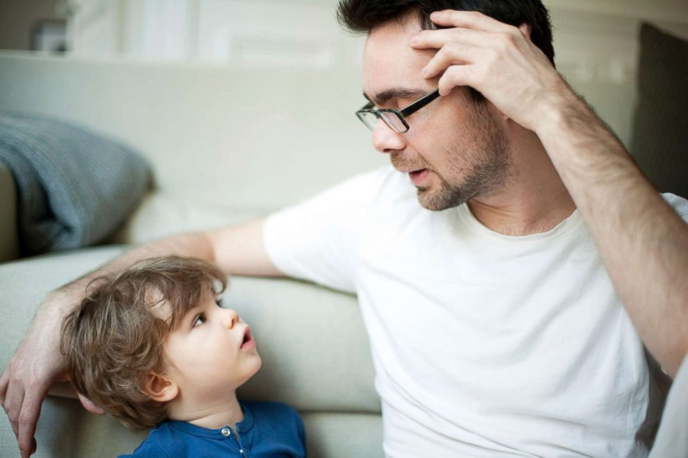 A father talks to his son in this undated stock photo.