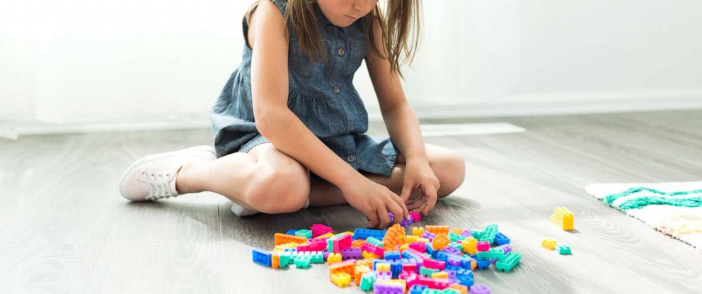 PHOTO: A young girl plays with blocks in this stock photo.