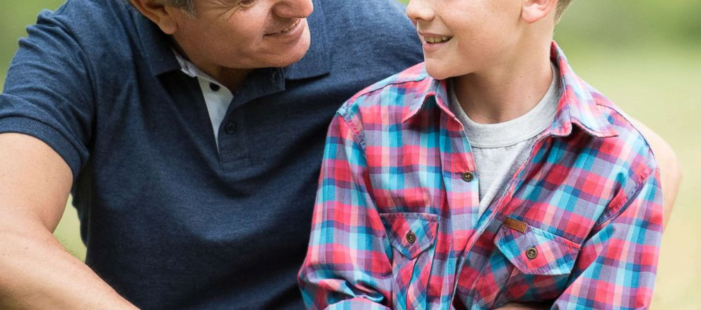 In this undated stock photo, a father has a conversation with his son.