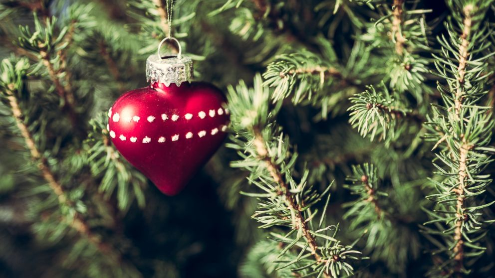 An undated stock photo shows a heart-shaped ornament on a Christmas tree.