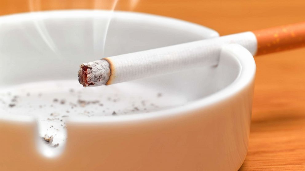 A cigarette sits in an ashtray in this undated stock photo.