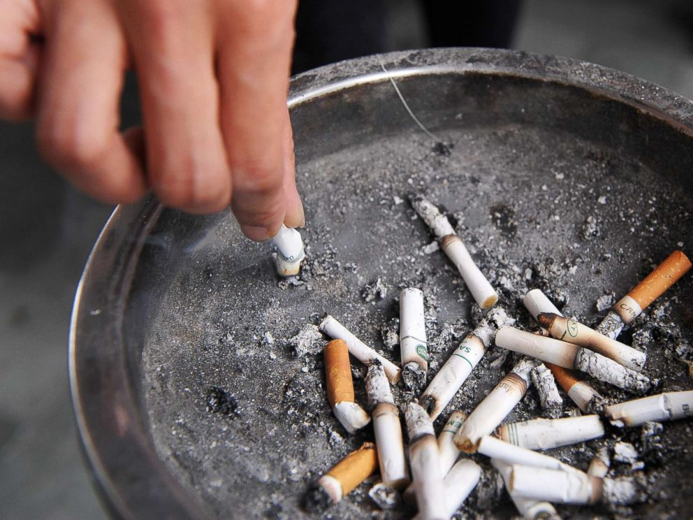PHOTO: A smoker stubbs out a cigarette outside a shopping mall in Hong Kong on June 27, 2009.