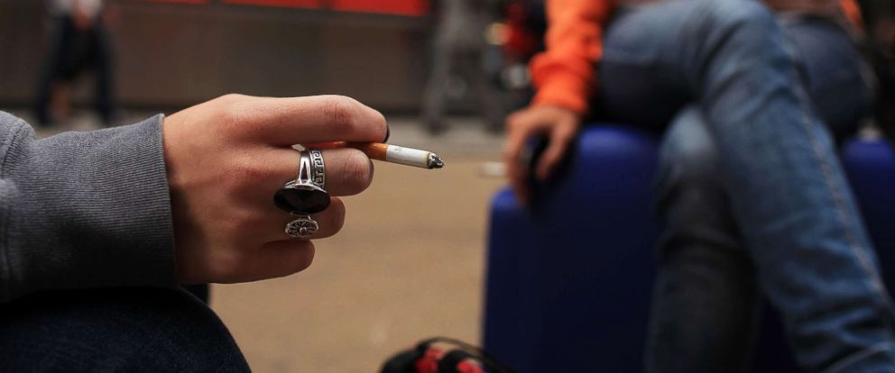 PHOTO: Women smoke in a Times Square pedestrian island on Sept. 16, 2010 in New York.