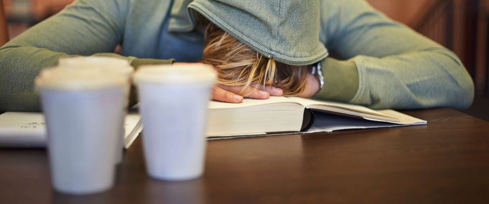 PHOTO: A young student suffering from the exhaustion of finals.