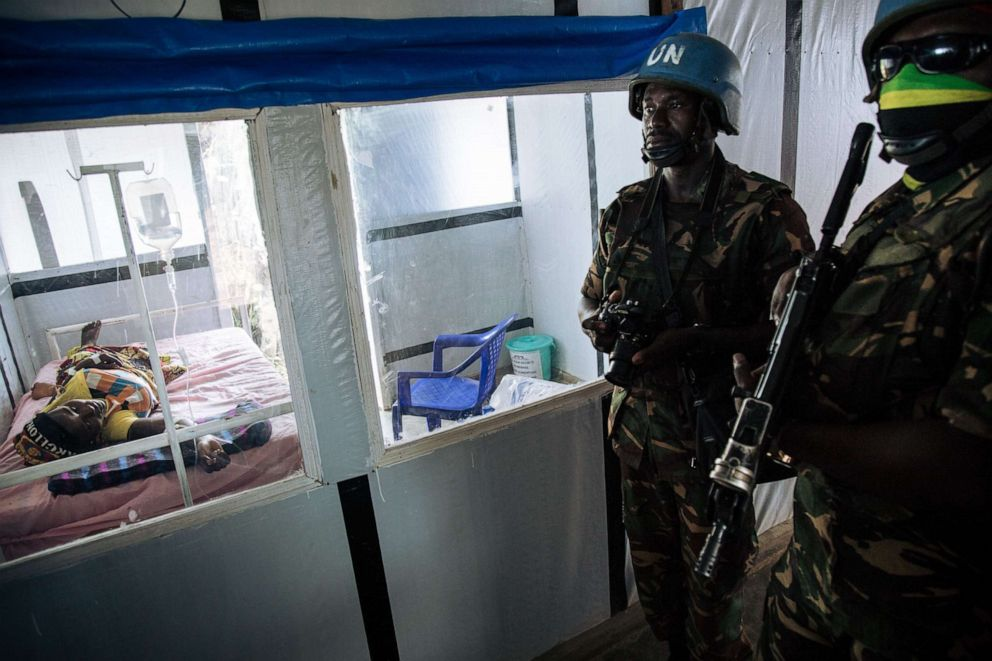 PHOTO: United Nations peacekeepers stand next to a patient during a visit of the UN Secretary-General at an ebola treatment center in Democratic Republic of Congo, Sept. 1, 2019.