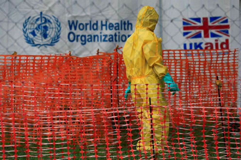 PHOTO: A person dressed in Ebola protective apparel is seen inside an Ebola care facility at the Bwera general hospital near the border with the Democratic Republic of Congo in Bwera, Uganda, June 14, 2019.
