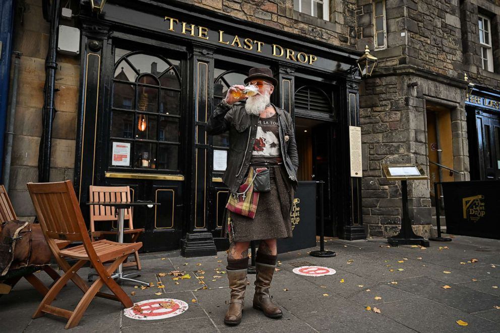 PHOTO: Charles Douglas Barr enjoys a pint outside The Las Drop pub in the Grassmarket on Oct. 7, 2020, in Edinburgh, Scotland.