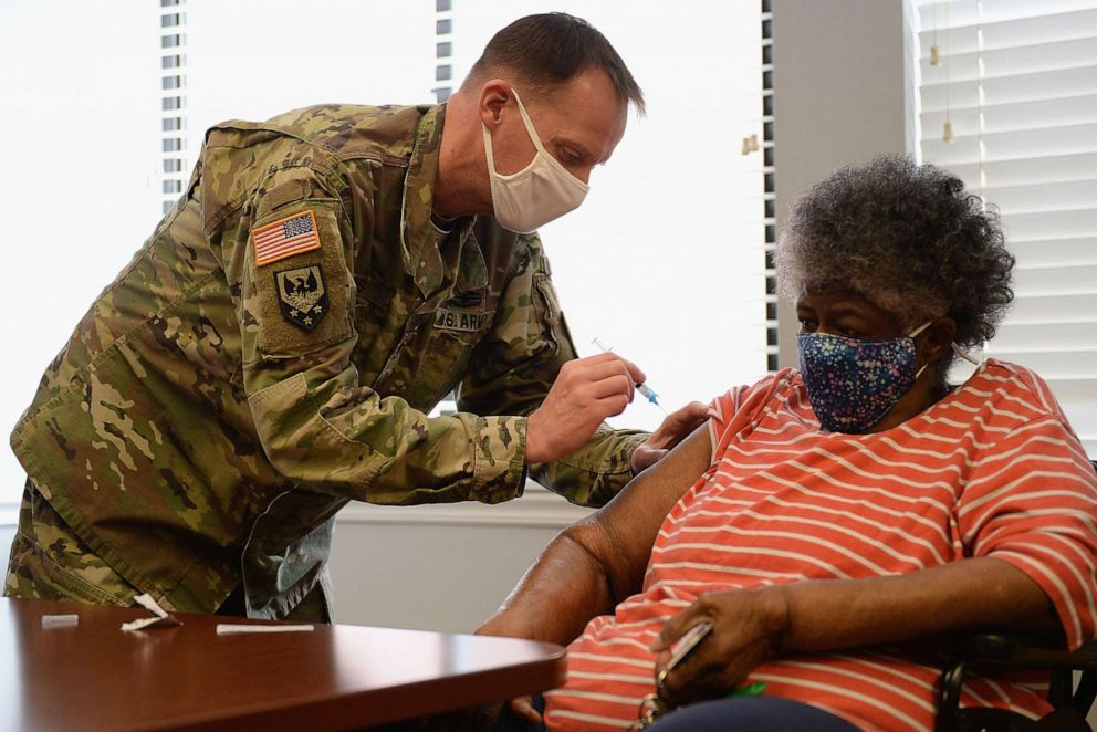 PHOTO: In this Feb. 11, 2021, file photo, Staff Sergeant Herbert Lins of the Missouri Army National Guard administers the Covid-19 vaccine to a resident during a vaccination event in St Louis, Missouri.